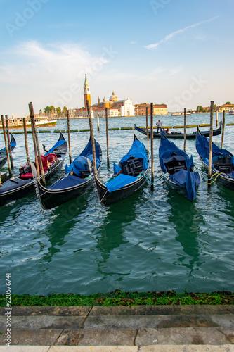 Foto op Plexiglas Venetie View of some fascinating docked gondolas in Venice Italy