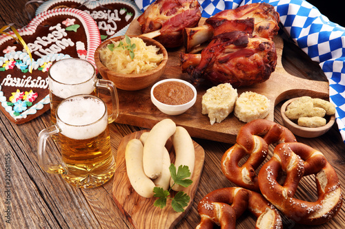 Traditional German cuisine, Schweinshaxe roasted ham hock. Beer, pretzels and various Bavarian specialties. Oktoberfest background