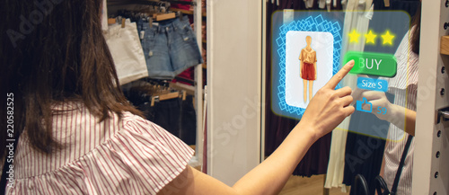 Fotografía iot smart retail futuristic technology concept, happy girl try to use smart disp