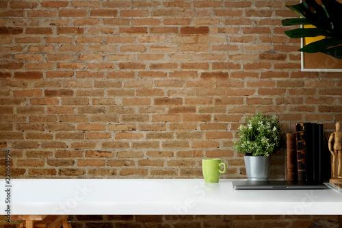 Obraz Mockup workspace vintage books, dry flower, office stationery and cork frame over red brick wall. - fototapety do salonu