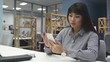 Asian Girl with Smartphone 7 in Office