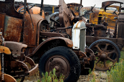 Photo Stands Ship Classic old rusty trucks in junkyard