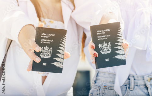 Fotografie, Obraz  Cropped shot view of young girls holding a New Zealand passport in their hands