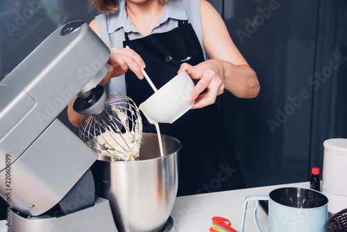 Fotografie, Obraz  Woman making mixer bakery cake machine