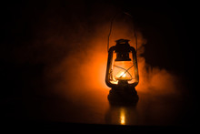 Oil Lamp Lighting Up The Darkness Or Burning Kerosene Lamp Background, Concept Lighting. Selective Focus