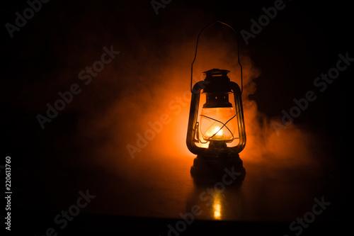 Oil Lamp Lighting up the Darkness or Burning kerosene lamp background, concept lighting Wallpaper Mural