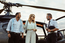 Couple Alighted From A Helicopter Thanking Pilot