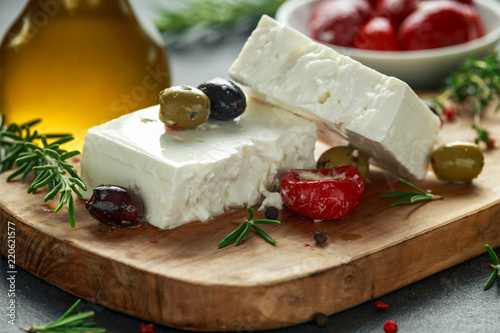 Fototapeta Greek cheese feta with thyme, rosemary, olives and stuffed red bell peppers obraz