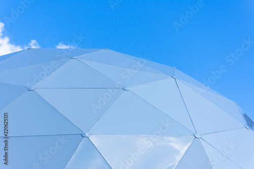 Obraz na płótnie Dome consisting of triangular pieces of shelter section on the sky background