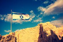 Flag Of Israel Against The Morning Sky. The Israeli Flag On Masada