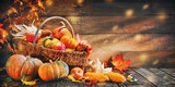 Fototapeta Fototapety do kuchni - Thanksgiving pumpkins with fruits and falling leaves