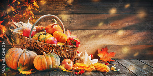 Fotobehang Herfst Thanksgiving pumpkins with fruits and falling leaves