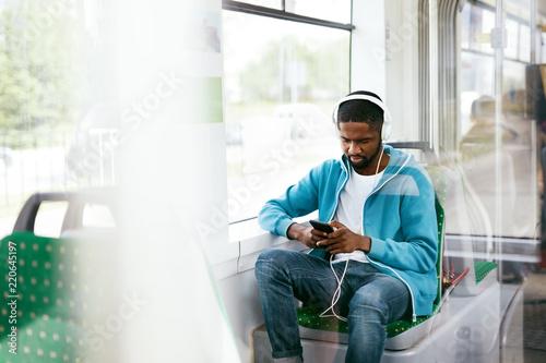 Man Riding In Bus Listening Music In Headphones