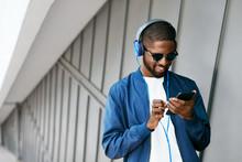 Music. Man With Phone Listenin...