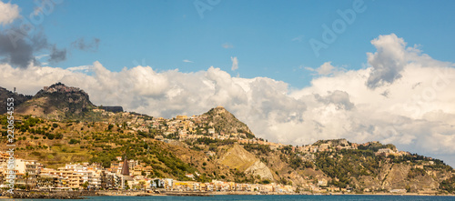 Sicilian landscape with amazing turquoise water. Mediterranean resort Giardini Naxos panoramic view.