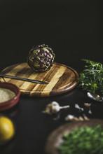 An Artichoke On A Wooden Table