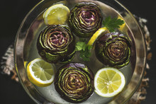 Artichokes In Water With Lemons For Flavouring