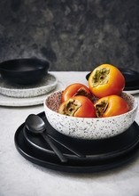 Fresh Persimmon In A Bowl On A...