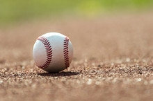 New Baseball Ball On Red Track Rubber