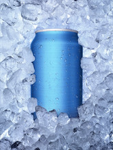 Cans Of In Ice On White Backgr...