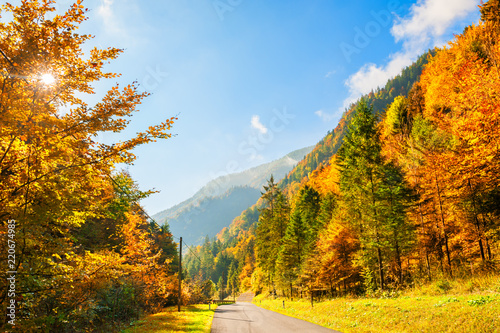 Road in autumn mountains, Alps, Austria. Beautiful autumn landscape