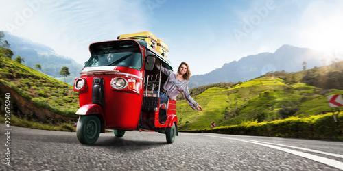 Fotografija  Happy woman travel by traditional srilankan transport, road near tea plantation