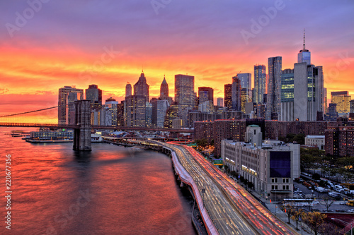 View of Lower Manhattan with Brooklyn Bridge at at Amazing Sunset, New York City
