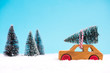 Wooden toy car carrying Christmas tree