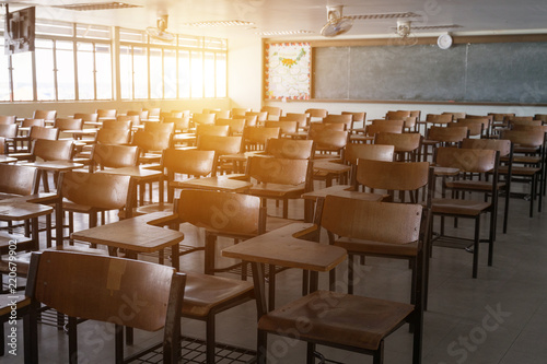 Empty classroom with vintage tone wooden chairs. Back to school concept.