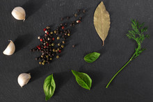 Garlick Fennel Pepper Of Basilic On A Black Stone Background