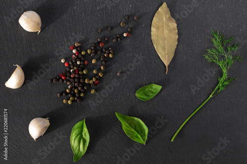 Garlick fennel pepper of basilic on a black stone background Wallpaper Mural