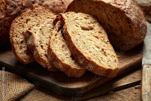 Foto op Plexiglas Brood sliced fresh baked bread on wooden background