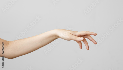 Female hand touching on gray background