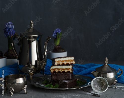 Coffee still life with chocolate cakes.