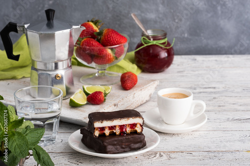 Chocolate cakes with fruits and coffee for breakfast.