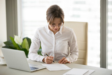 Serious Successful Businesswoman Puts Signature On Business Contract, Millennial Female Entrepreneur Signing Paper Doing Paperwork At Workplace, Woman Boss Working With Documents In Office