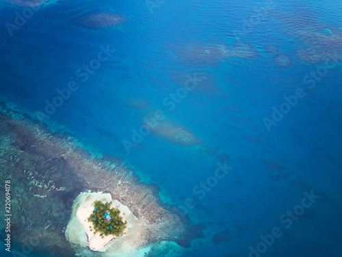 Deurstickers Tropical strand Blue sea water with coral reefs