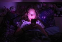 Little Girl Lying Under A Blan...