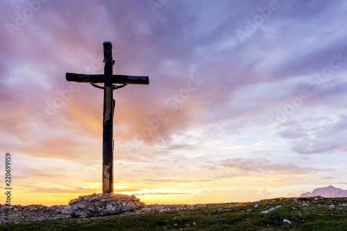 An Evocative Religious Cross on the Mountain Peak at the Sunrise Time with a Bea Canvas-taulu