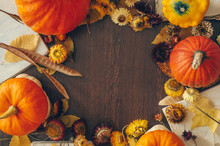 Thanksgiving Background With Autumn Dried Flowers, Pumpkins And Fall Leaves On The Old Wooden Background. Abundant Harvest Concept