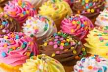 Colorful Cup Cakes On Wooden B...