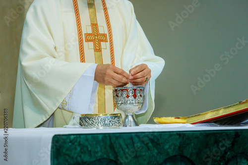 Fotografie, Obraz  Breaking the bread in the church during the communion