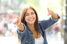 Joyful Girl Pointing At Camera...