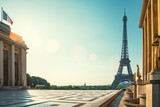 Fototapeta Paryż - Paris street with view on the famous paris eiffel tower on a sunny day with some sunshine