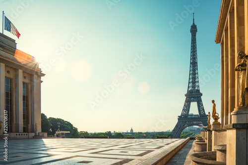 Paris street with view on the famous paris eiffel tower on a sunny day with some sunshine