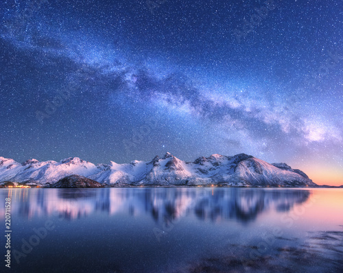 Bright Milky Way over snow covered mountains and sea at night in winter in Norway Canvas Print