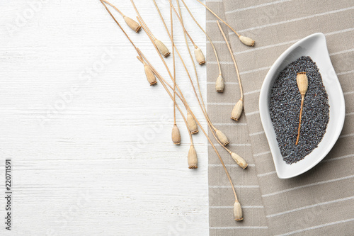 Fotobehang Poppy Flat lay composition with poppy seeds on wooden background