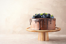 Fresh Delicious Homemade Chocolate Cake With Berries On Table Against Color Background. Space For Text