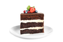 Plate With Slice Of Chocolate Sponge Berry Cake On White Background