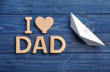 Flat Lay Composition With Phrase I LOVE DAD And Paper Boat On Wooden Background. Father's Day Celebration